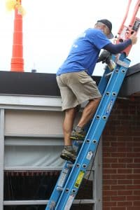 Kendal Bauman, elementary PE teacher, heads up to the roof