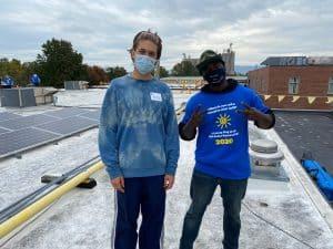 Noah Heie, community volunteer, and Nikita Stoll '14 and employee of Got Electric, LLC