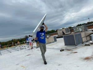 Joshua Kraybill '10, Got Electric at the solar barn raising