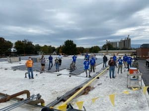 Volunteers at the solar barn raising