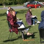 Choir practicing outdoors for COVID mitigation, fall 2020