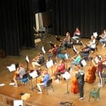 Nov. 23, orchestra performs for the faculty and staff, in the balcony