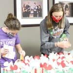 Student volunteers pack the faculty/staff gift boxes