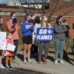 Flames fans send off the boys varsity basketball team to the state semi final game