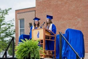 Emma Myers and Maggie Fairfield, commencement 2021