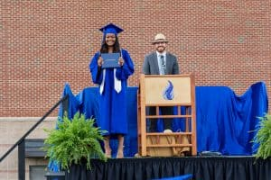 Rahel Lema and Princiipal Justin King, commencement 2021