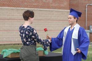 Leah Huyard, 6th grade teacher, greets her brother Luke, commencemnt 2021