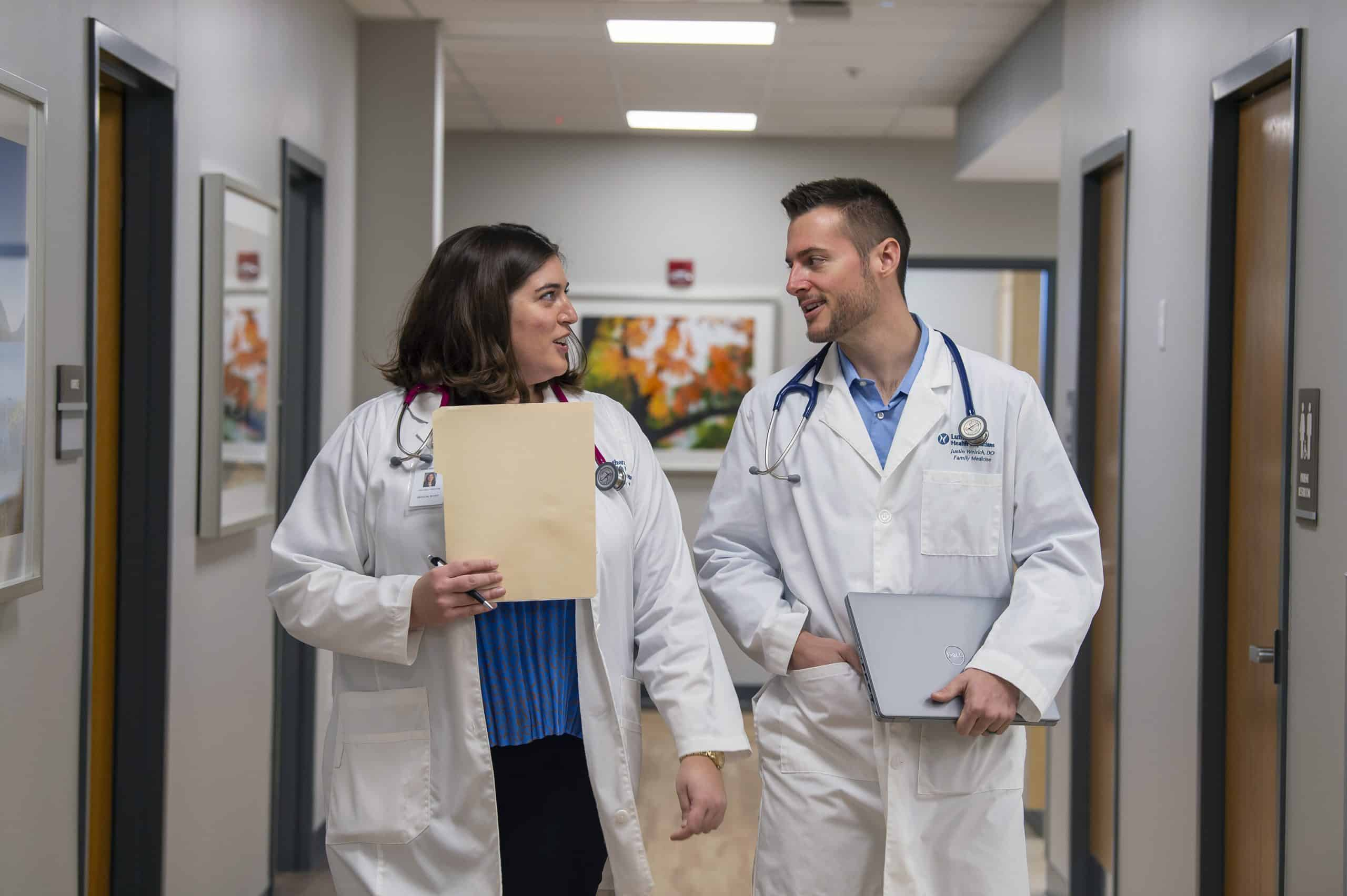 Dr. Justin Weirich 'o6 (right) with a colleague at Lutheran Health Physicians, Fort Wayne, Ind. Photo credit Tim Brumbleloe.