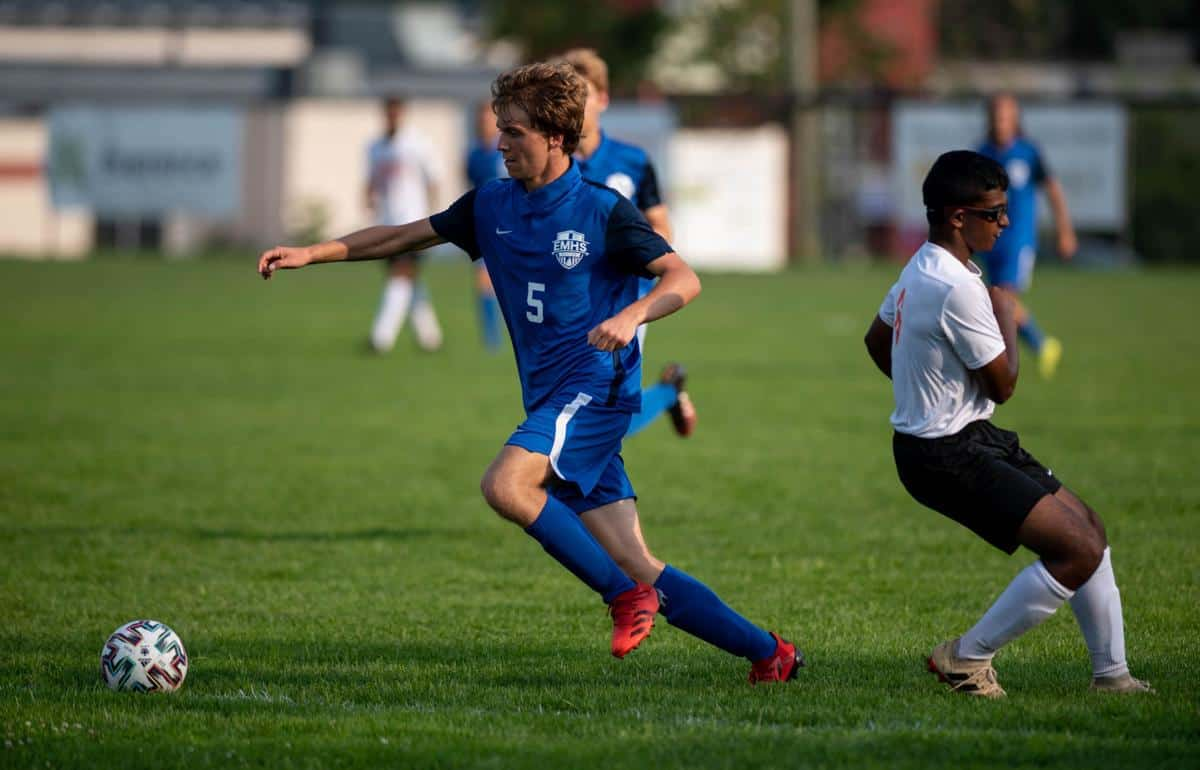 Ezra Miller '22 blows past a Hargrave defender. Photo by Daniel Lin/DN-R