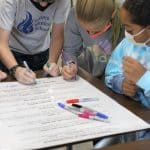 Fifth grade students take turns singing the peace pledge, 2021