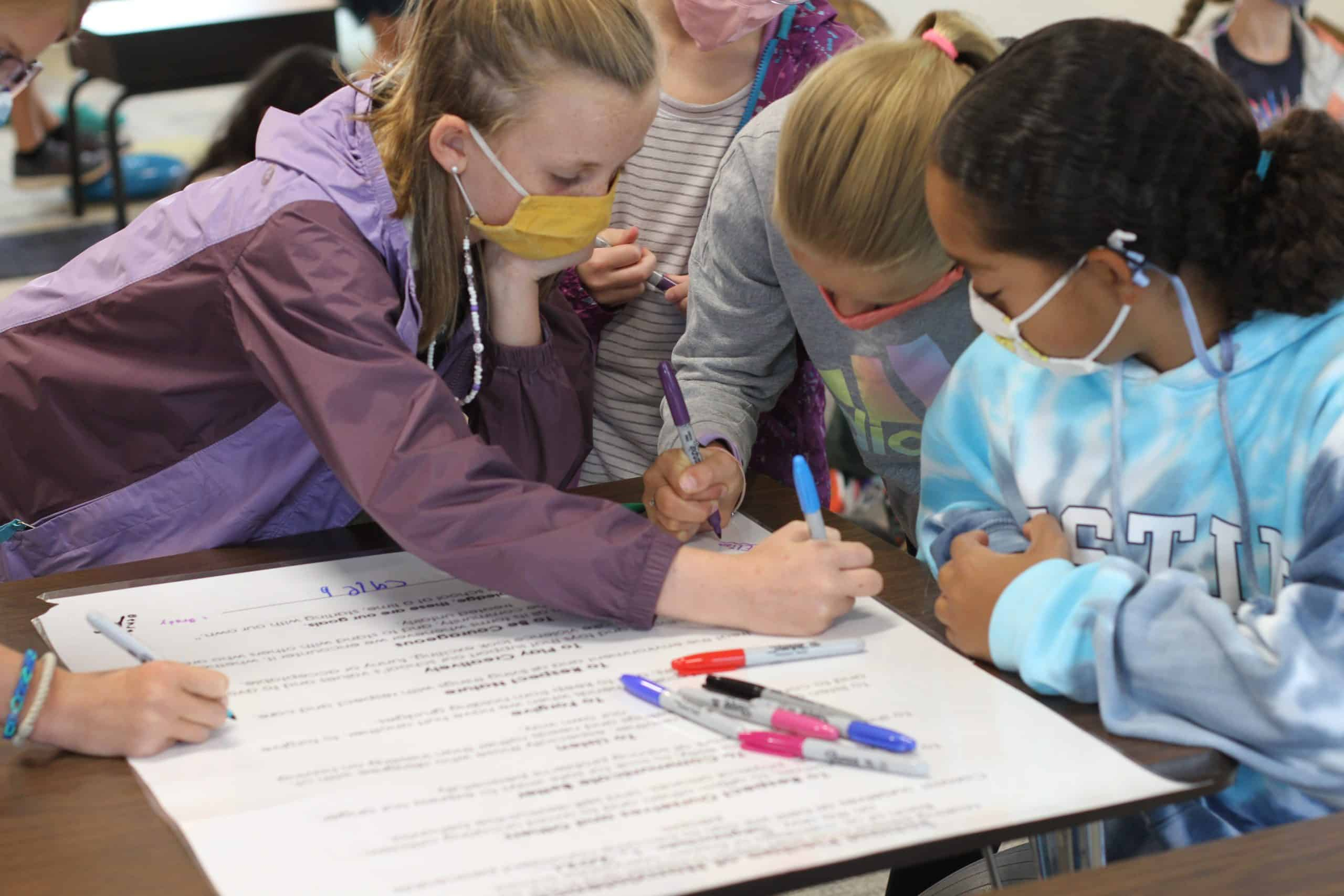Fifth grade students sign the elementary school peace pledge, fall 2021