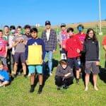 Varsity cross country team members at the Virginia Mennonite Relief Sale 2021.