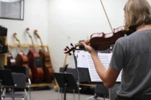 Miriam on violin in strings music room